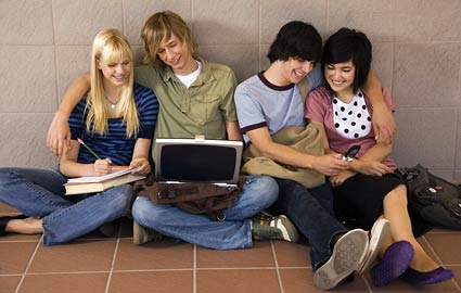 teens-texting-computer-425ds011310