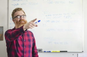 man-teaching-class_t20_YQpeQ1